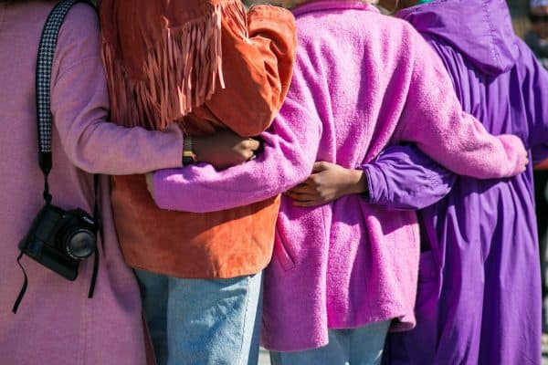 female friends, women wearing jackets, pink, purple, orange, fringe, women, friendship, crowdfunding women, women crowdfunding
